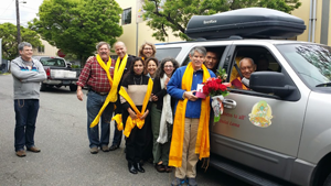 Lama Zopa Rinpoche (front seat) and Yangsi Rinpoche (back seat) depart Maitripa College to conduct prayers in Washington, bid farewell by the staff of the FPMT International Office and Maitripa College