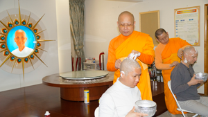 The ordinants' heads are shaven before the ceremony