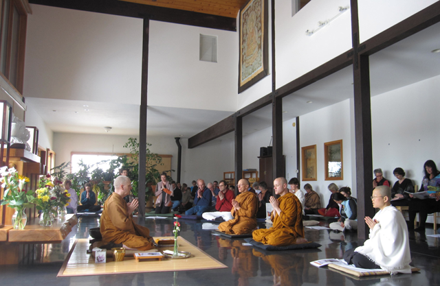 Chanting Welcome back and happy 60th birthday blessings for Ajahn Sona, in Birken's main practice hall