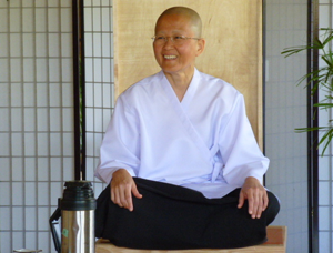 "Sister Mon, also known as ""Maechee-in-charge"" during Ajahn Sona's retreat"