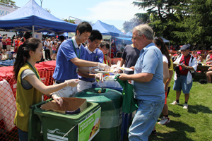 Tzu Chi volunteers help with recycling and promote environmental care at the Canada Day Festival in Richmond
