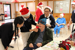 Tzu Chi volunteers celebrate the Christmas holiday with residents at Fraserview Senior Care Lodge