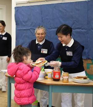 Tzu Chi volunteers prepare and serve breakfasts to students at Windsor Elementary School