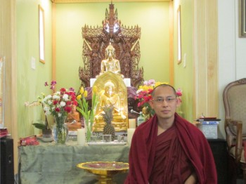 Ven. Pannobhasa sitting before the altar in the Dhamma Gone Yee Snohomish monastery