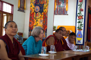 Representatives of Tibetan Nuns Project, the Tibetan government's Department of Religious Culture, and participating nunneries observe the oral debate exam. These include TNP co-directors Elizabeth Napper, center; and Lobsan Dechen, to her right