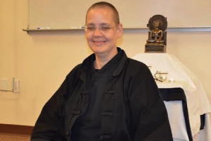 Ann Tjhung, a lay Buddhist practitioner, leads the Buddhist practice at JBLM