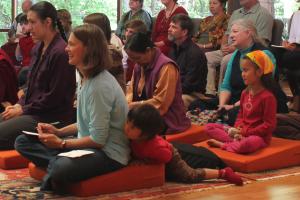 Tibetan translator Heidi Nevin with children attending event at Saraha Nyingma Buddhist Institute