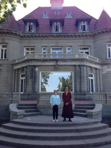 Chamtrul Rinpoche and Jacqueline Mandell in front of Pittock Mansion, a Portland museum