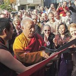 Dzogchen Ponlop Rinpoche, left, and Khenpo Tsültrim Gyamtso Rinpoche, cut the ribbon to open Nalanda West in November 2004 while Lynne Marvet, right, beams