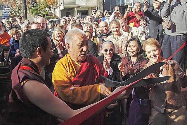 Dzogchen Ponlop Rinpoche, left, and Khenpo Tsültrim Gyamtso Rinpoche, cut the ribbon to open Nalanda West in November 2004 while Lynne Marvet, right, beams