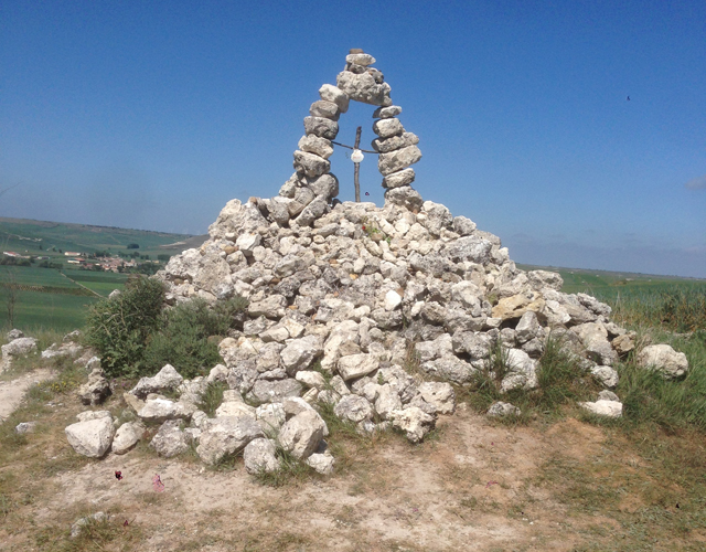 So many pilgrims have walked the Camino de Santiago that they've left this rock cairn.
