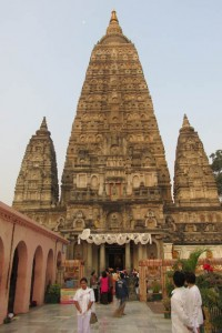 A constantly changing river of pilgrims meditate, circumambulate and pray at the Mahabodhi Stupa, the focal point of pilgrimage to Bodh Gaya.
