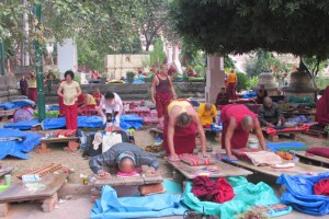 Early every morning mainly Tibetan practitioners do full prostrations, facing the stupa.
