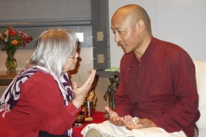Anam Thubten speaks with student Tanya Schubert of Whidbey Island, north of Seattle