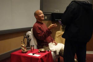Anam Thubten makes a clarifying dharma point (open hand)
