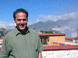 Jim Blumenthal on the Johkang temple in Lhasa, Tibet, with the Potala Palace in the background
