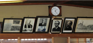 The back wall of the temple, with pictures of mentors and inspirational figures who were priests or civil rights activists--including Asano himself, right under the clock.