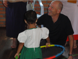 Roger Brain teaching a pre-K student how to use a hula-hoop in Nyaung Palin village in the Belin area of Myanmar. Over the past six to seven years, we have built a large pre-K, K, primary and middle school compound with assembly hall there.