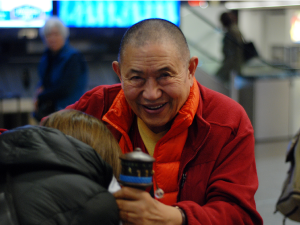 H.E. Garchen Rinpoche greeting students on his arrival at Sea-Tac airport in 2013.