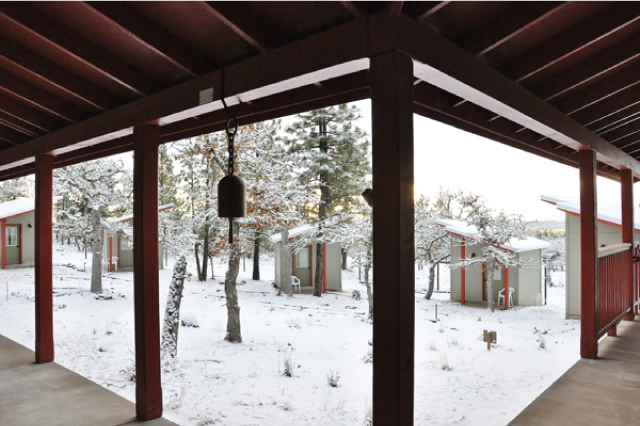 Retreat cabins on a snowy day in the south cloister at Ser Chö Ösel Ling.