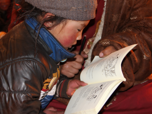 A student learning to read.