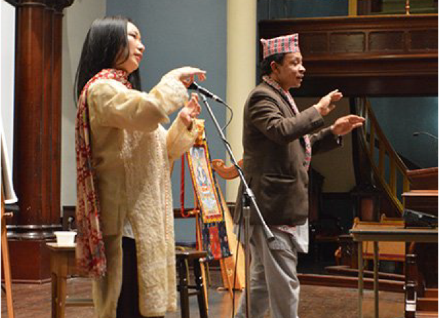 Prajwal Ratna Vajracharya and Corinne Nakamura-Rybak from Dance Mandal in Portland, demonstrate traditional Nepali dance.