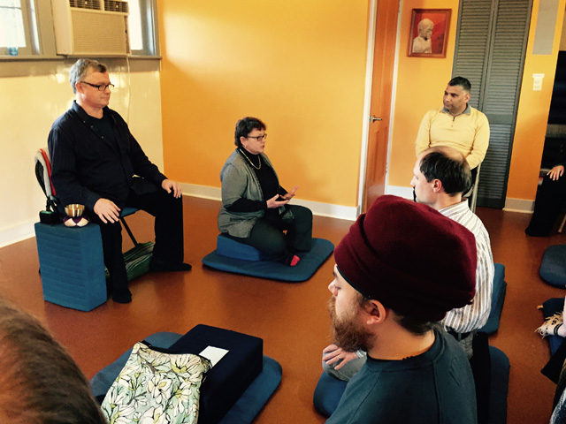 Senior Teacher Mary Bolton begins meditation instruction with the basics, like how to sit on a meditation cushion. Peter Allen is in the umdze, or timekeeper's, chair