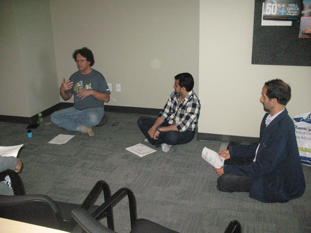 """Tim Tapping teaching the monthly intro to meditation class """"Beginner's Mind."""" Left to right, Tim Tapping, unidentified, Ram Hariharan"""
