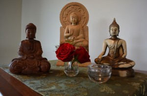 "Buddhas from the three resident sanghas, united on a side altar symbolizing the ""coming together"""