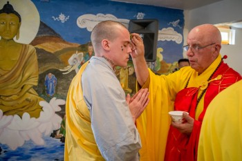 Chris Richards receiving water blessing from Abbot Thich An Giao