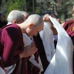 Lama Tsang Tsing offers a ceremonial khata scarf to retreatant Liza Baer
