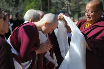 Lama Tsang Tsing offers a ceremonial khata scarf to retreatant Liza Baer
