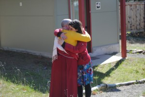 Retreatant Hanna Karlin says goodbye to her daughter before entering retreat