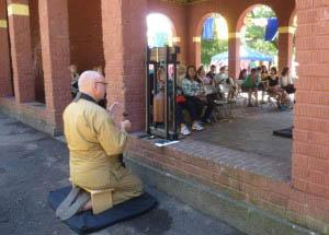 Anthony Fujaku Stevens ringing the 108 bells to begin