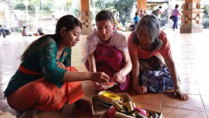 Maria Antilla and Suzie Scollon, Taradhatu members, learning to make flower offerings in Bali