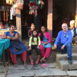 Bill Hason visiting with people from the village where he first served in the Peace Corps