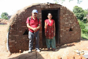 Chij Shrestha with a woman who will live in the new house built for her after the earthquake