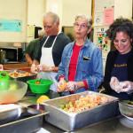 Nalandabodhi Seattle members (L to R) Don Ross, Susan Kirchoff and Damayonti Sengupta help prepare Friday Feast