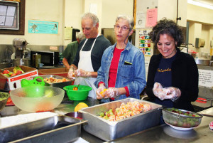Nalandabodhi Seattle members (L to R) Don Ross, Susan Kirchoff and Damayonti Sengupta help prepare Friday Feast
