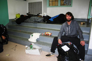 """Travis Gowan, 26, used to sleep at the ROOTS shelter, but he recently """"aged out"""" and now sleeps on the streets. Here he awaits a recent Friday Feast"""