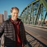 Author Paul Louis Metzger, standing on a bridge in Portland