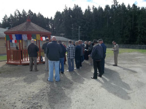Residents of McNeil Island, and friends and supporters, at the dedication ceremony
