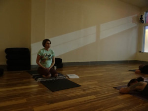 Maurer teaching at Tiger Lily, a yoga studio in Seattle's Rainier Valley