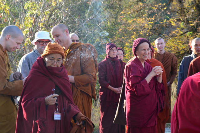 The monastics light incense before the land-blessing ceremony