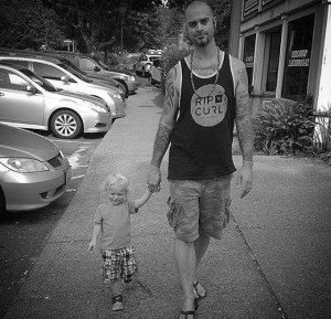 Damien Abel walking with his son