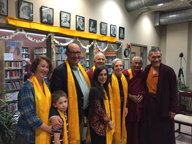 Yangsi Rinpoche, Geshe Tenzin Dorje and the family of Jim Blumenthal in front of the James A. Blumenthal Library at Maitripa College, in October