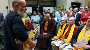"""Jerry Joseph performs """"Craters of the Moon,"""" enjoyed by Geshe Tenzin Dorje, Yangsi Rinpoche, Susan and Jack Blumenthal, and a crowd from the Maitripa College community"""