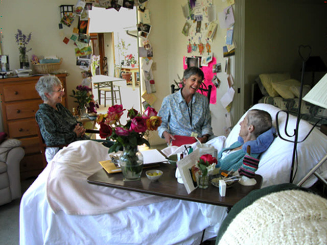 Volunteers supporting an Enso House guest, near the end of life