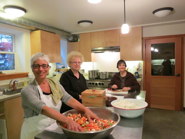 100 Meals cooks in the zendo kitchen left to right, Dee Seishun Endleman, Anne Sendo Howells and Sally Zenka Metcalf