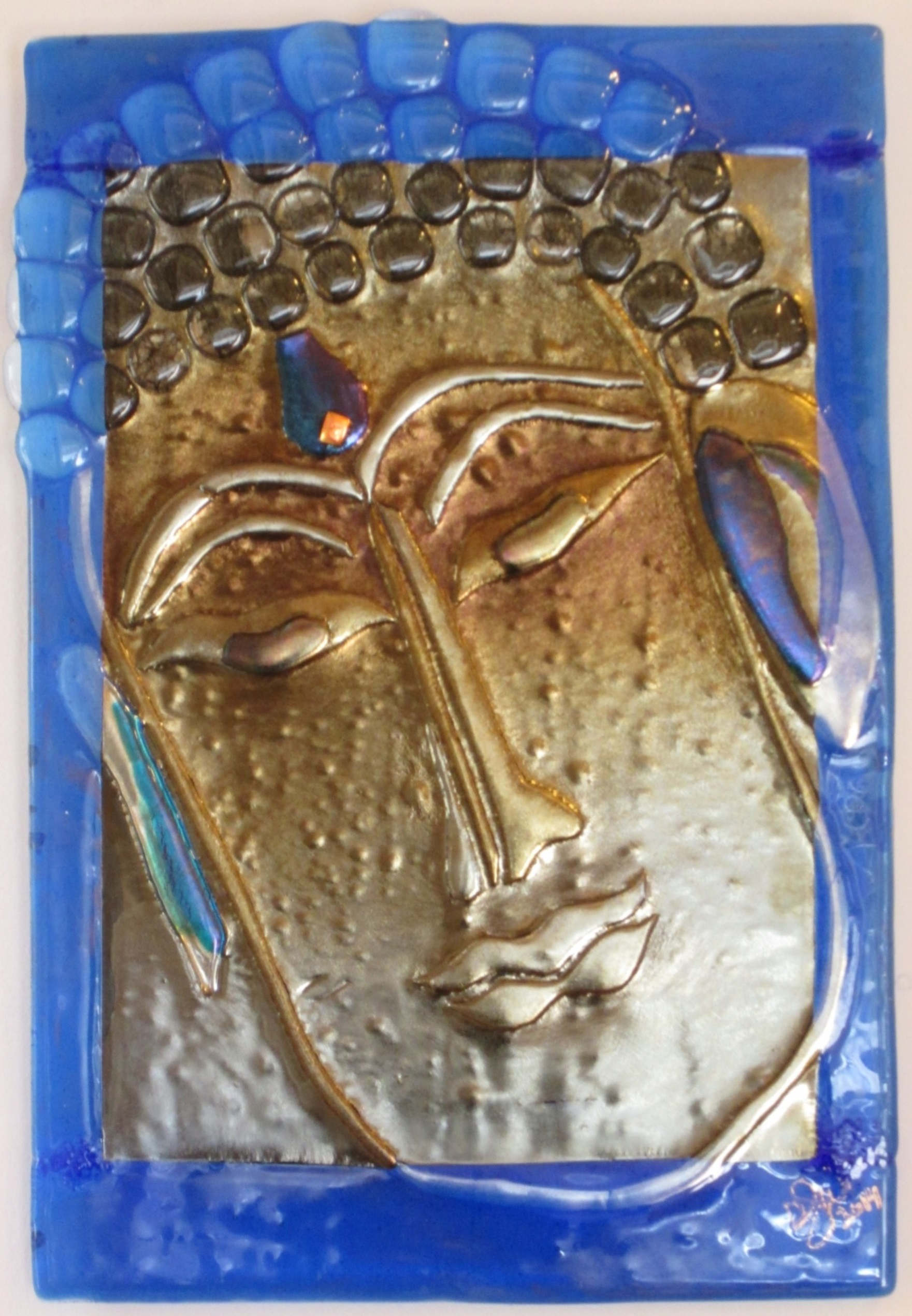 A compassionate Buddha, created by Jill Whitmore of kiln-formed glass, sometimes in six layers
